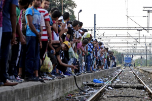 Image 2: Refugees wait in long lines for the approaching trains in the scorching heat on the platform of Gevgelija. Thousands take the Balkanroute from Syria, Iraq or the African countries via Turkey and Greece to Western Europe. Many cross Macedonia, which is completely overwhelmed with the situation. These refugees' next goal is Serbia, 200 kilometres away. © Ognen Teofilovski / Reuters